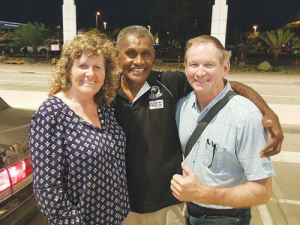 Lynette and Rex Smith with David (Tevita) Draunimasi who lost an arm in a tractor accident many years ago. He does all the tractor work on the farm. One of David's sons, Sailasa, is farm manager.