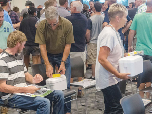 Dairy farmers collect their individualised milk sampling packs at the start of the first nationwide Mycoplasma bovis testing programme. This time farmers do not have to take samples themselves.