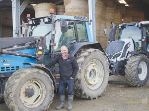 Chris Kenel with his Valtra tractors. Kenel says the only thing that has worn out is the seat (right).