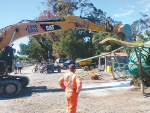 Fonterra emergency response team members help recover a collapsed fertiliser tank in Kaikoura.
