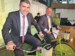 Peddling kiwifruit: Government ministers Nathan Guy and Craig Foss use pedal power to mix a kiwifruit smoothie at the recent parliamentary reception to celebrate the recovery of the kiwifruit industry.