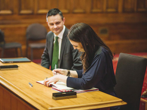 James Shaw and Jacinda Ardern signing the deal.