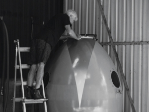 Tony Bish gets a closer look at the inside of the fermenting egg.