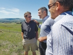 Sharing some smiles while surveying the effect of the North Canterbury drought from the top of Red Oaks Station are Weka Pass Station owner Richard Murchison, left,  Minister for Primary Industries Nathan Guy and Local MP for Kaikoura Stuart Smith.
