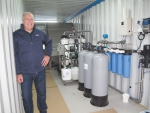 Terry Hawes and the prototype effluent treatment system.