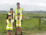 Helensville farmers Scott and Sue Narbey with Bella and Ollie.