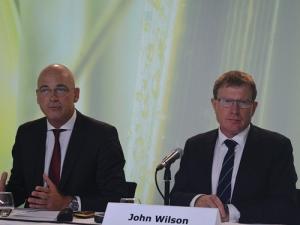 Fonterra chief executive Theo Spierings makes a point to journalists while chairman John Wilson looks on.