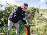 James Wang from Lincoln Agritech installing a HydroMetricsTM nitrate sensor in a monitoring well in Canterbury. SUPPLIED/Lincoln Agritech