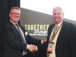 Farmlands chief executive Peter Reidie shakes hands with NZ National Fieldays Society head Peter Nation.