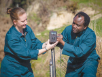 Dr Rene Corner-Thomas and PhD student Aloyce Bunyaga set up a camera.