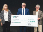 Rural Youth and Adult Literacy Trust trustees Jo Poland and Barry O'Donnell receiving the donation from Fieldays chief executive Peter Nation.