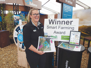 Erica Leadley, South Island regional manager of the Ballance Farm Sustainability Team, displays the award at SIAFD.