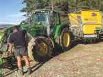 Washing down machinery on Ben Walling and Sarah Flintoft's M. bovis-infected farm at Lumsden. SUPPLIED