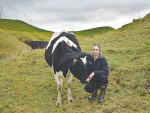 Tania Cresswell with one of her Holstein Friesian heifers.