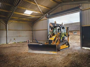 A JCB ICX-T levelling a barn.