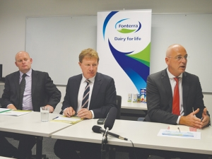 Under pressure: Fonterra shareholders council chair Duncan Coull; board chair John Wilson and chief executive Theo Spierings face journalists after the annual meeting.