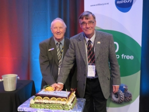 RCNZ life members Bryan Murray, Canterbury, and Colin Mackenzie cut the anniversary cake to celebrate 20 years of the association of Rural Contractors New Zealand.
