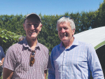 Chris Morrison (left), chair of Organic Aotearoa NZ on-orchard in Opotiki with Hon Damien O'Connor, Minister for food safety.
