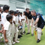 Stephen Fleming and Nathan Guy coach cricket for Sri Lankan children.