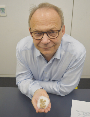DSM chief executive Christoph Goppelsroeder with a handful of 3-NOP pellets.