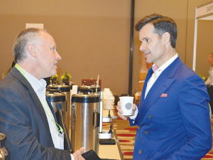 Lino Saputo Junior (right) chats with Richard Lange, Milk2Market at the Australian Dairy Conference..
