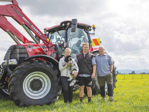 Sam Cane (centre) is pictured with his deer farming parents Kathy and Malcolm in front of their Case Puma 165.