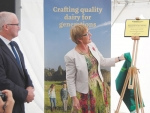 Food safety Minister Jo Goodhew unveils the plaque while Westland chairman Matt O'Regan looks on.