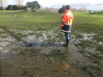 A Waikato Regional Council officer inspecting the extent of over application of effluent at the Trinity Lands farm