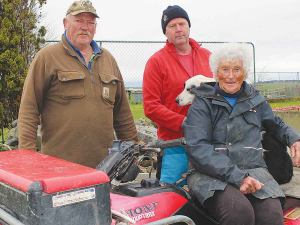 Suzanne Giesen with her boys Robbie (left) and Hamish who are called in to help out on the farm.